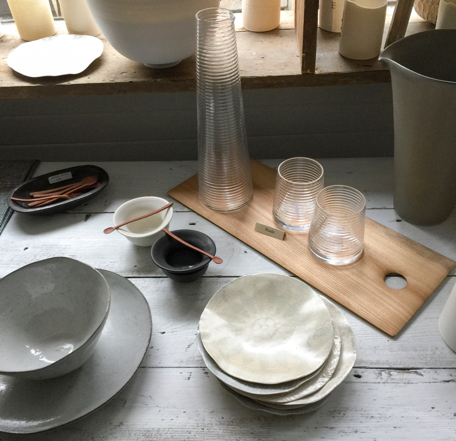 Wood cutting board by John Tildesely used as tray for ribbed glass jug by Nude Glass Poem and ceramic lace plates by Fliff Carr at Maud & Mabel