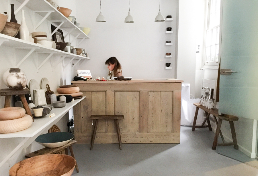 Pared back, minimal shop interior with white walls and gray concreted floor at Maud & Mabel