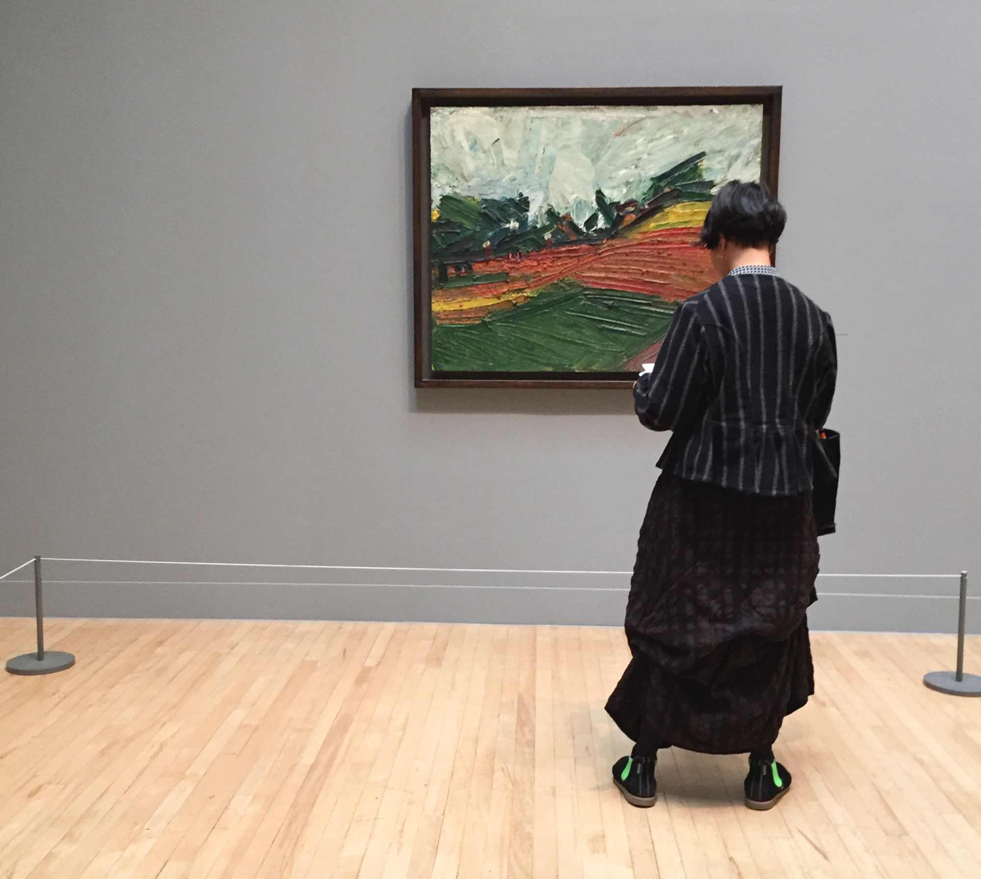 Woman looking at Frank Auerbach painting at Tate Britain