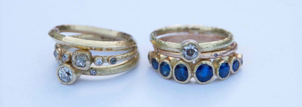 Sapphire and diamonds in gold ring settings