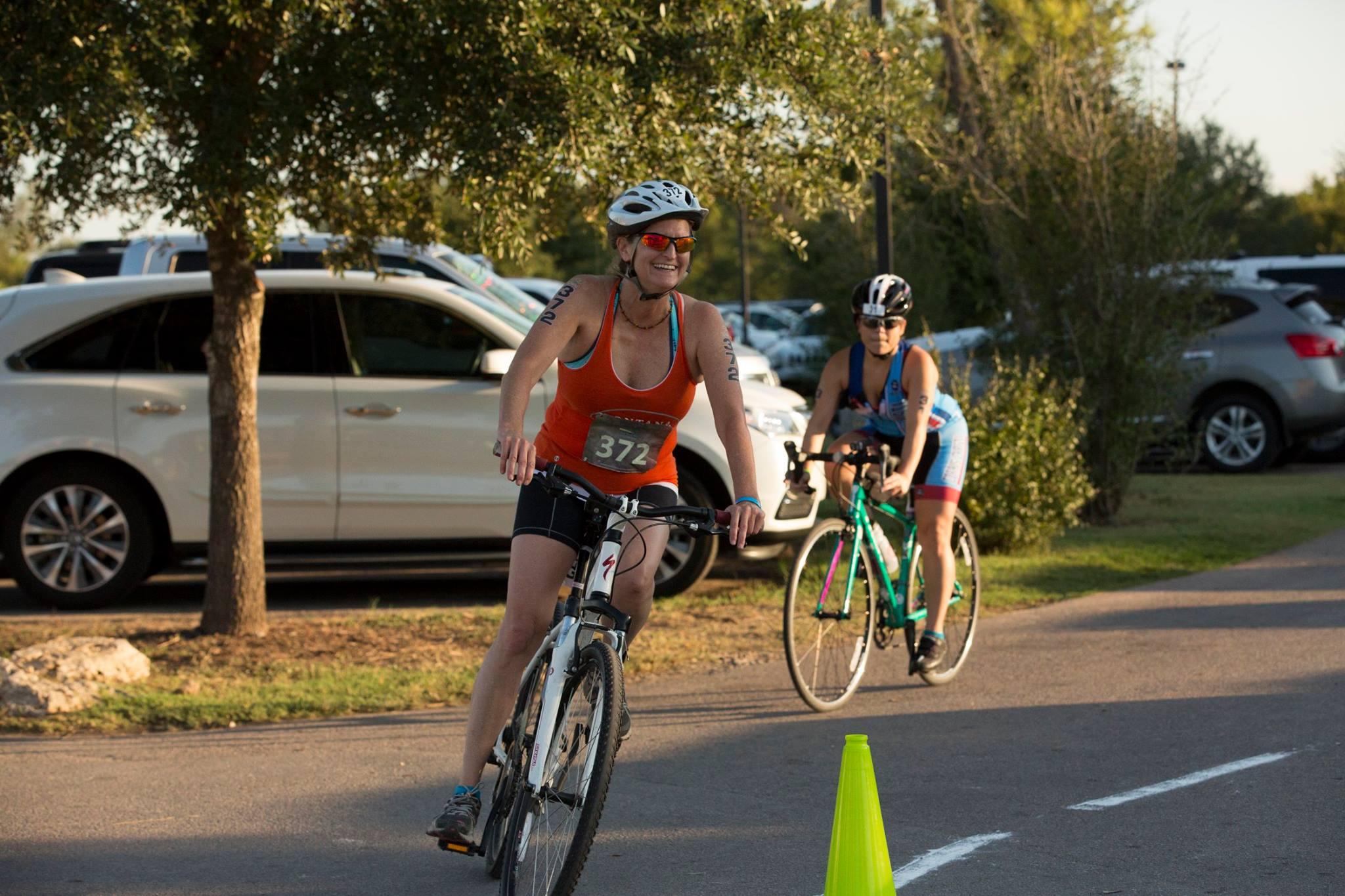 Jeannie Ralston biking in triathlon