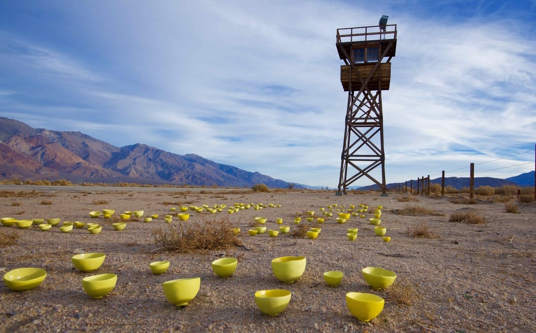 Yellow bowl project under watchtower in Manzanar, Setsuko Sato Winchester