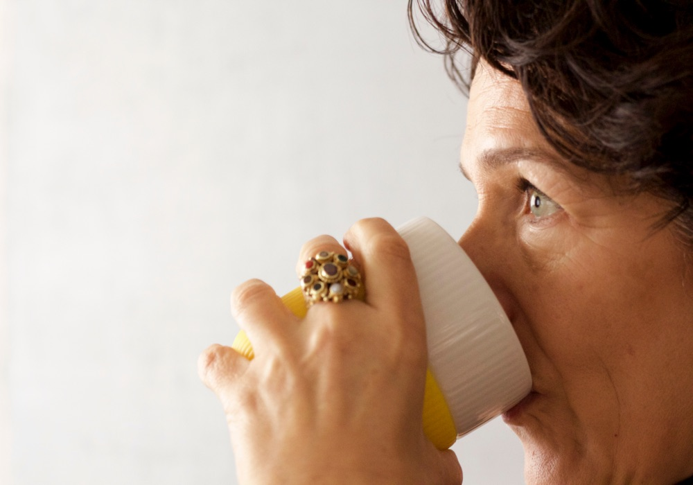 Profile of woman drinking from a mug