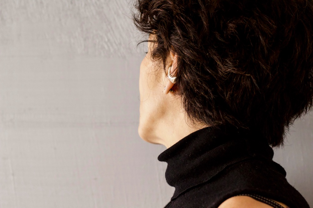 Profile of woman with ear cuff