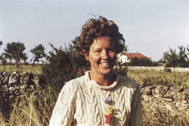 Art and the Environment: Sally Arnold — Fabulous Fabsters, Young woman with landscape of Southern Italy behind her.