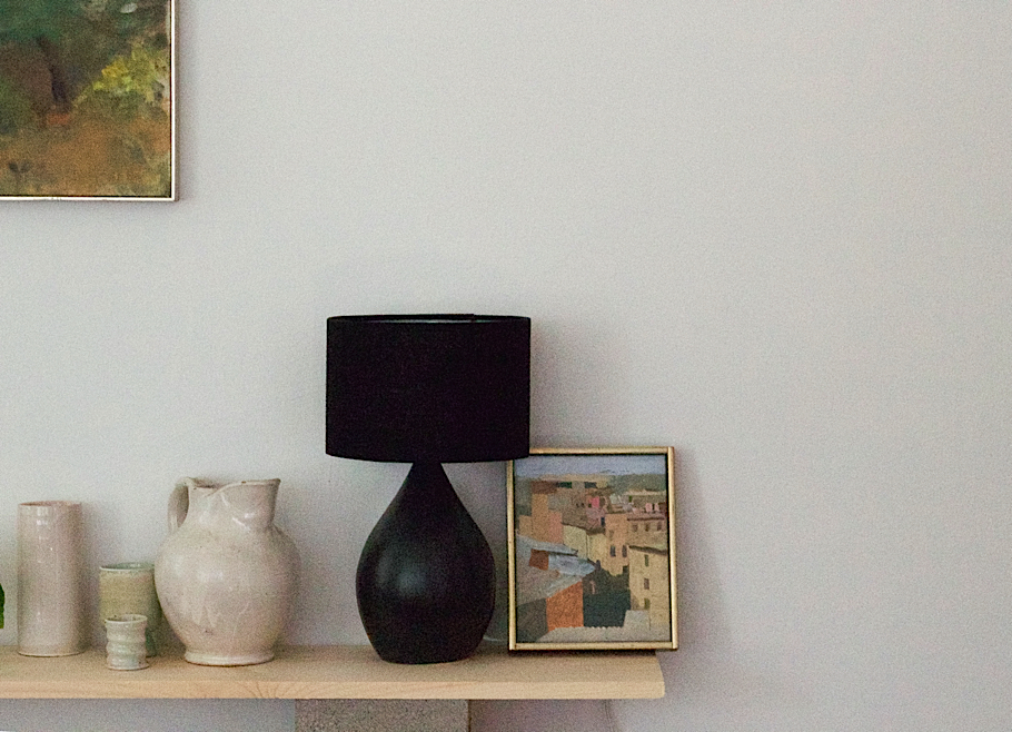 Julie Carlson Brooklyn Apartment, Still life with white ceramics and black lamp from Canvas Home, Arthur Cohen painting, plywood and cinder block shelves| Fabulous Fabsters