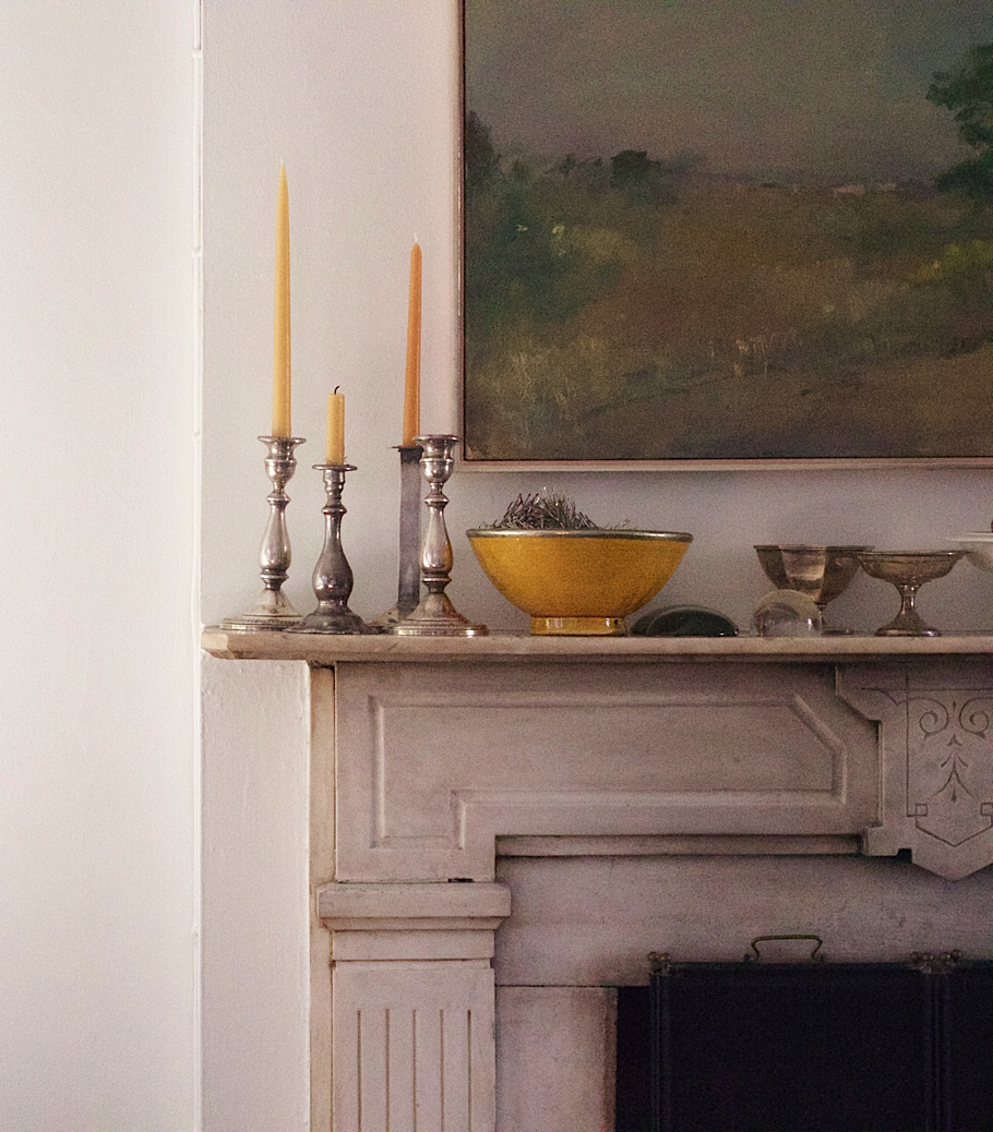 Julie Carlson Brooklyn Apartment, Robert Dutoit painting over Victorian Mantel, Vintage silver candlesticks with beeswax candles | Fabulous Fabsters