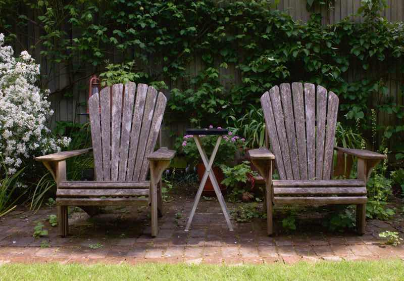 Garden Designer, Non-Morris, author of The Dahlia Papers, two weathered adirondack chairs in garden | Fabulous Fabsters