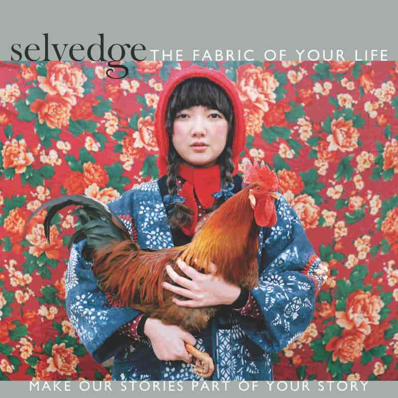 Chinese woman dressed in blue with red had holding a rooster in front of red floral wallpaper on the cover of Selvedge, a textile magazine.. Photo by Shuwei Lui.