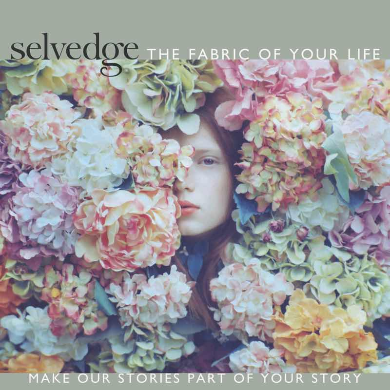 Woman's face surrounded by delicately hued flowers on Cover of Selvedge, a textile magazine.. Photo by Oleg Oprisco.