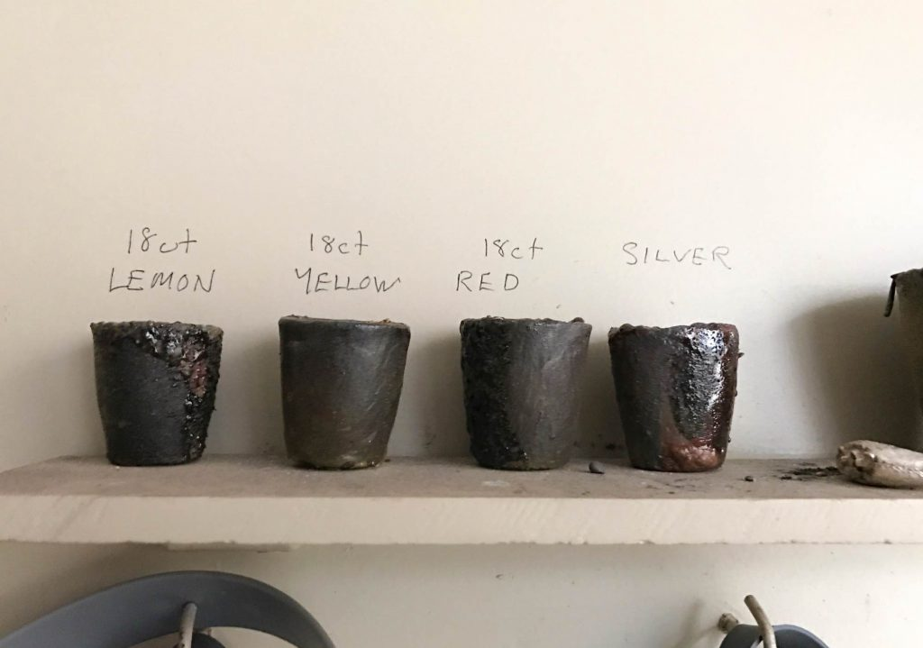 Cups for melted metals for jewellery making on a shelf