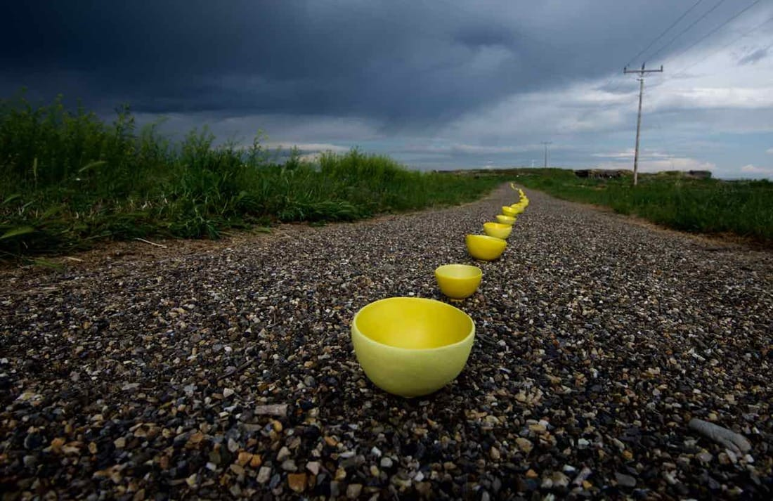 Yellows bowls lined up in Minidoka, Idaho. Photography by Setsuko Winchester.