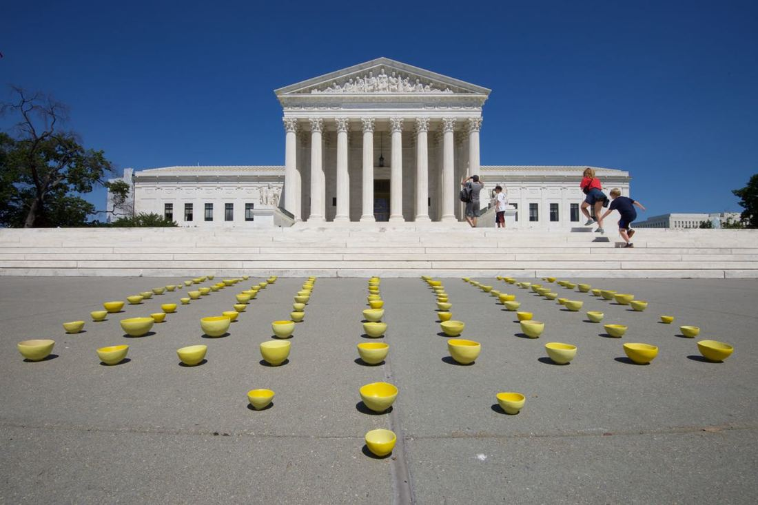 Yellow bowls in rows laid out in rows in front of the Supreme Court. Setsuko Sato Winchester
