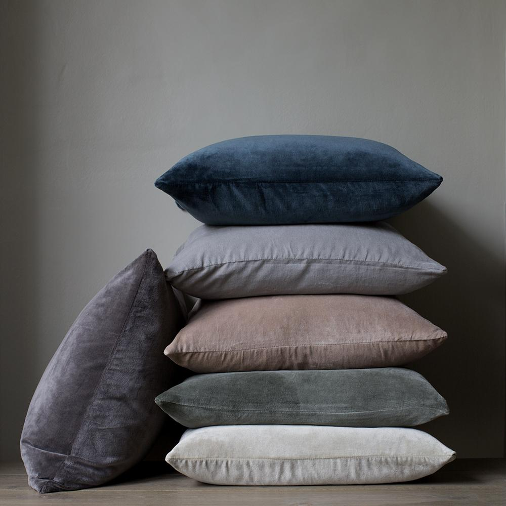 Stack of hand dyed velvet cushions