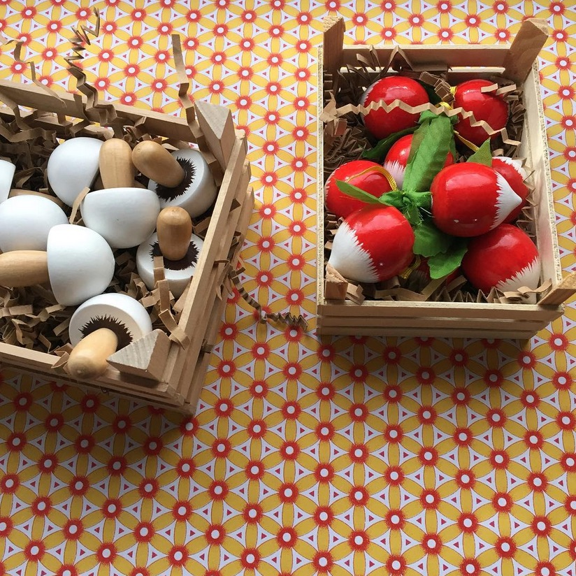 Wooden mushrooms and radishes in traditional crates, Hedgehog Shop