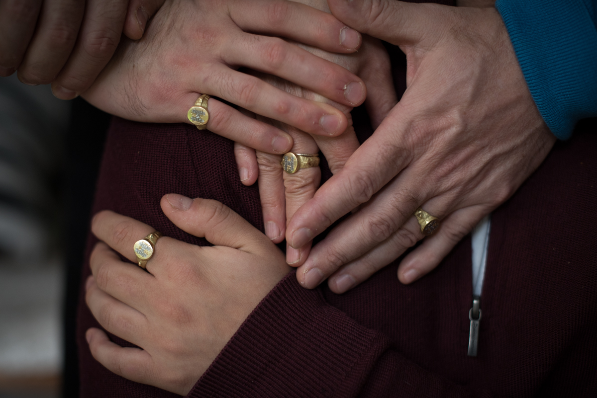 Four hands with signet rings. Photograph by Fiona Bailey. Photograph by Fiona Bailey