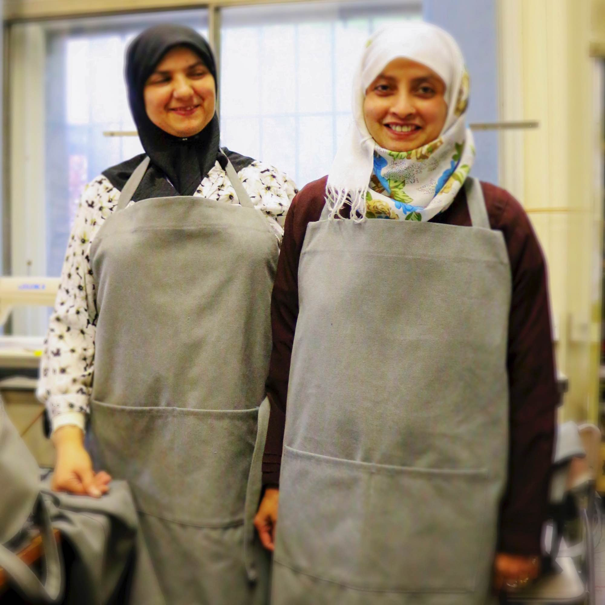 Aerende — ethical interiors, life-improving homewares. Two women wearing aprons