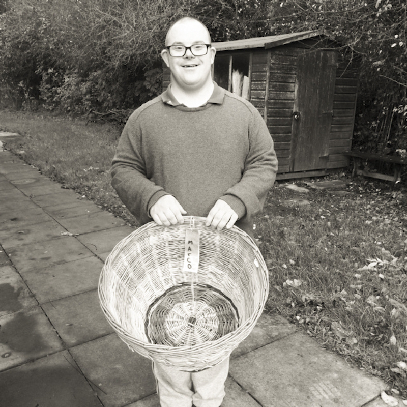 Aerende — ethical interiors, life-improving homewares. Man holding wicker basket.