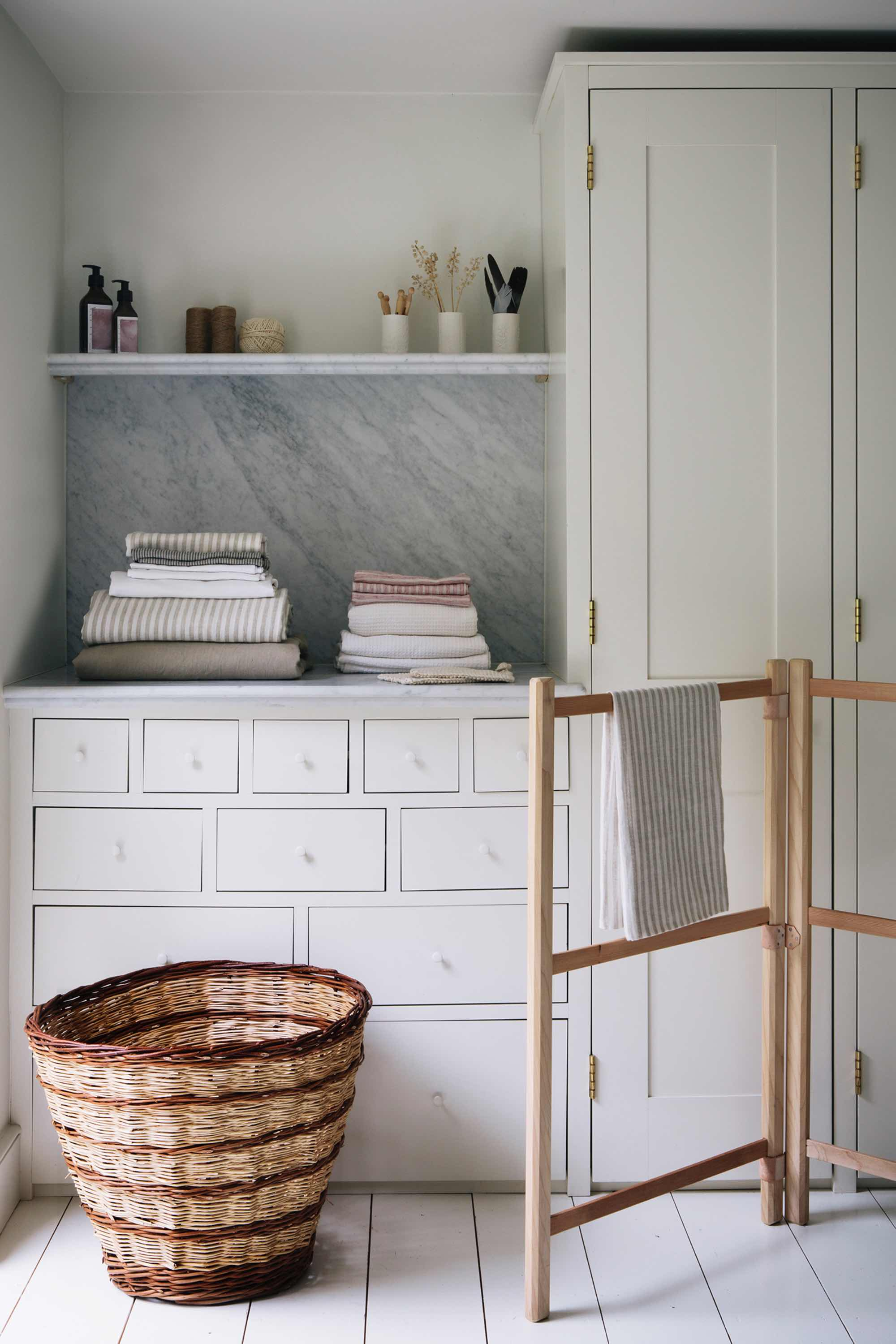 Aerende — ethical interiors, life-improving homewares — wicker basket and wooden clotheshorse in a white room