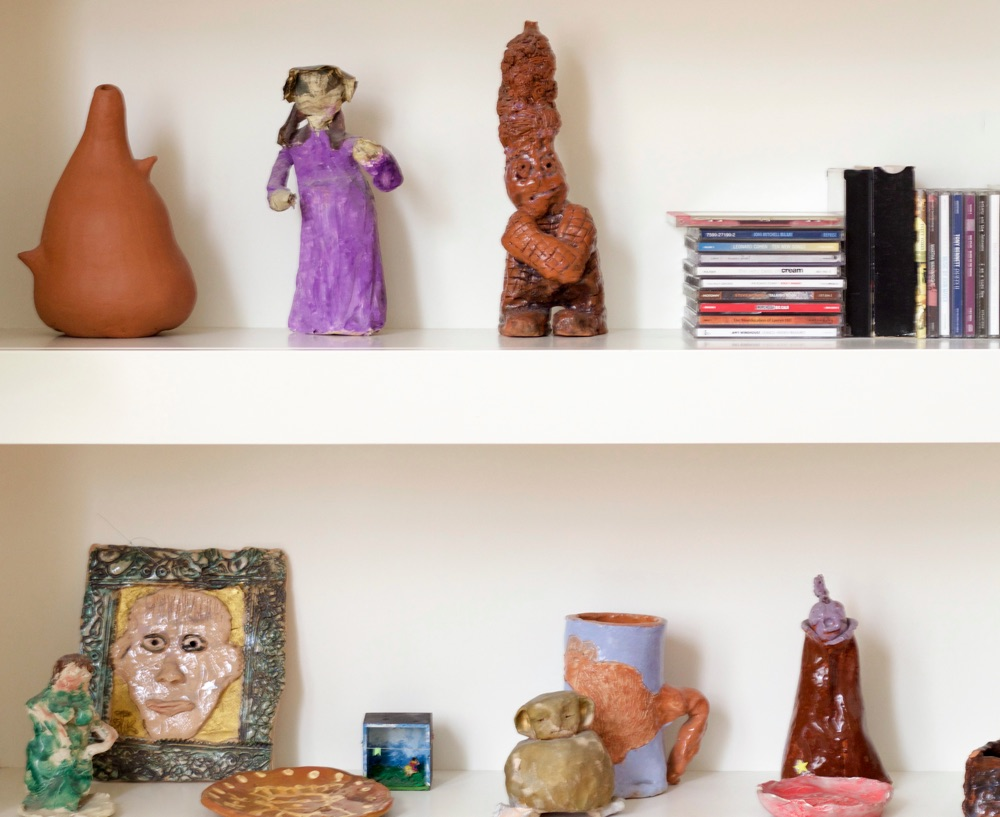 Shelves with ceramics made by children