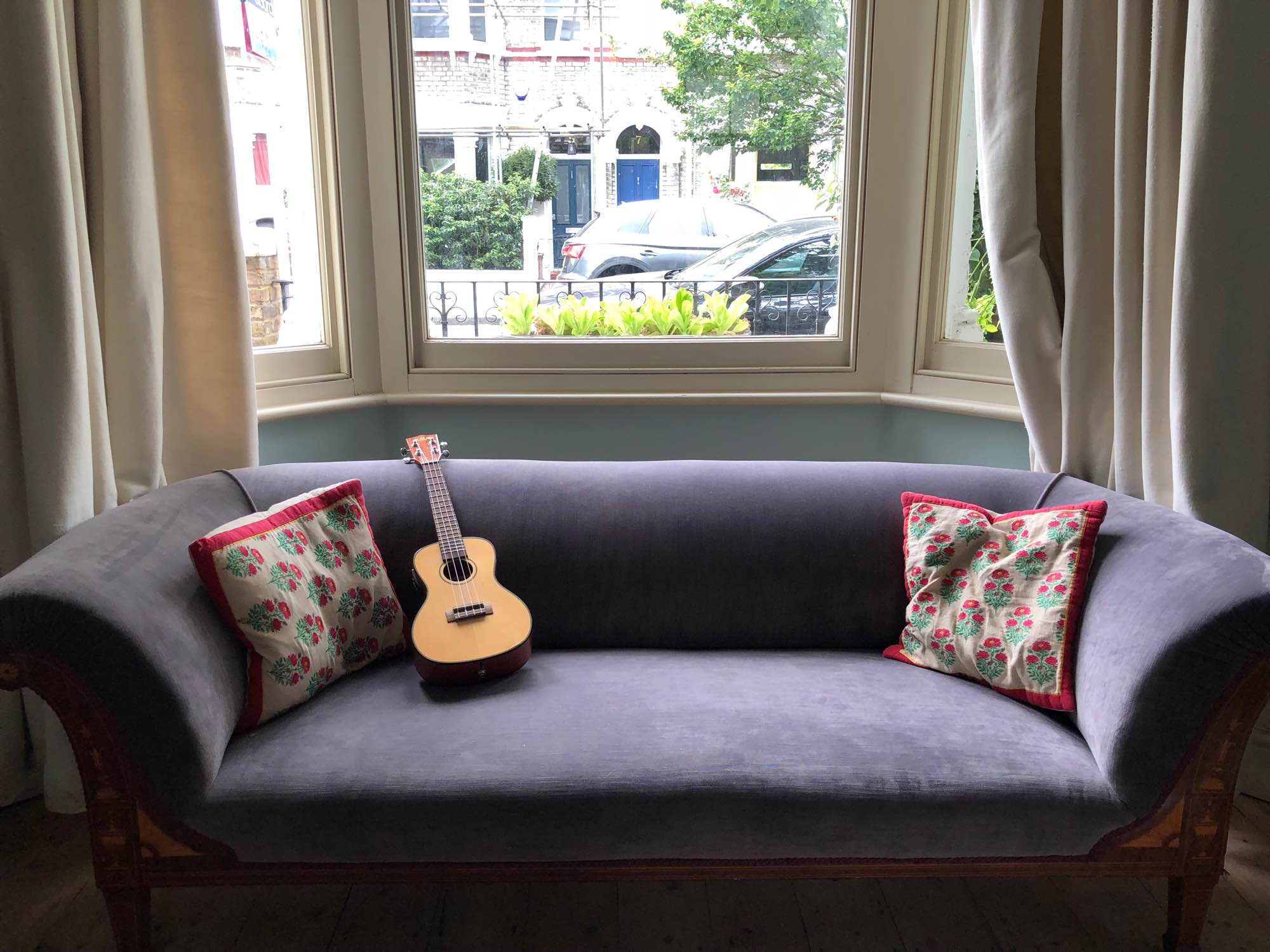 Ukelele resting on sofa in home of Idler Academy programme director Victoria Hull — Fabulous Fabsters