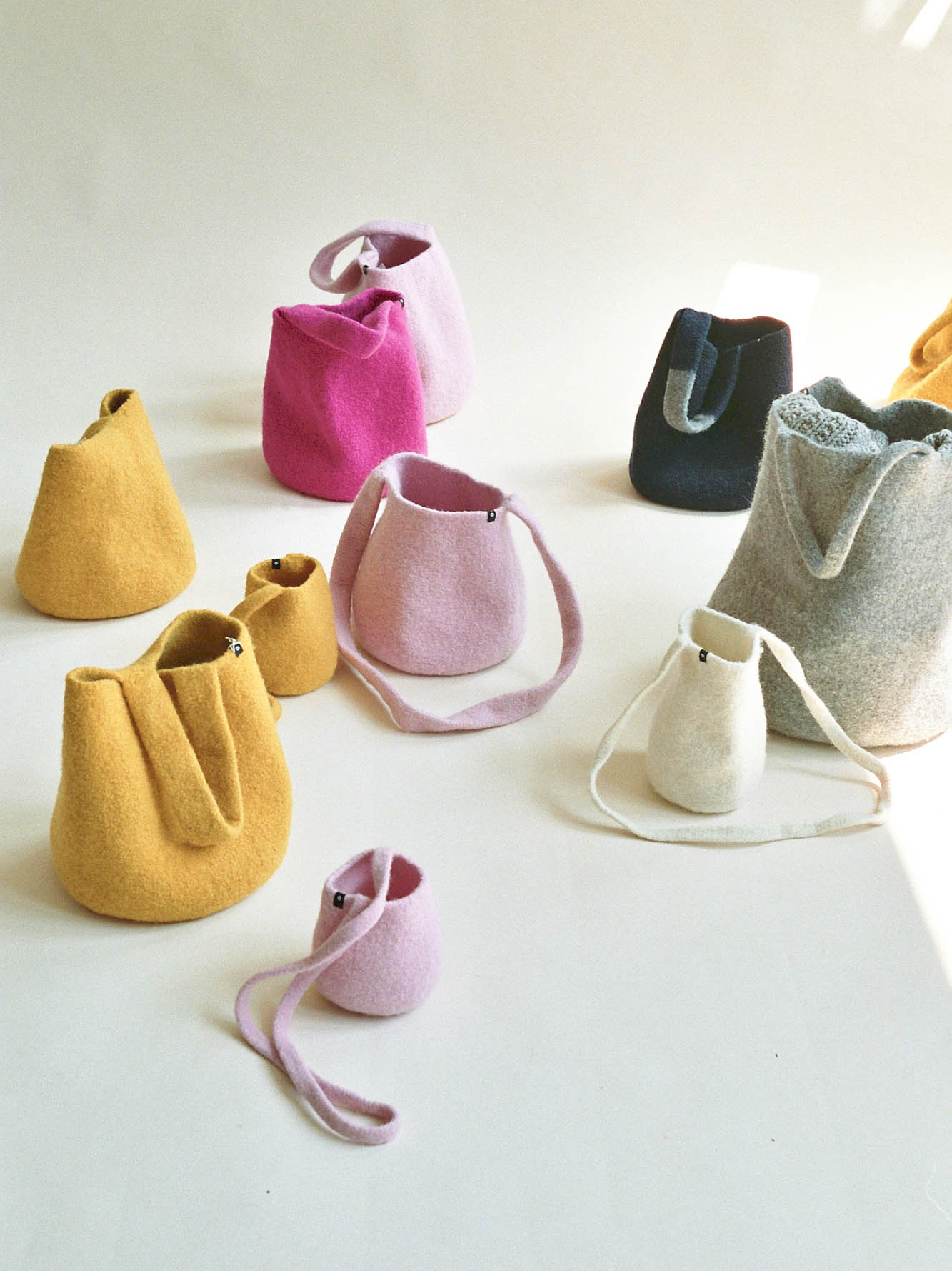 "Cecilie Telle, ""It Bags"", Bucket and Ball Bags in yellow, pink, magenta, gray, black"