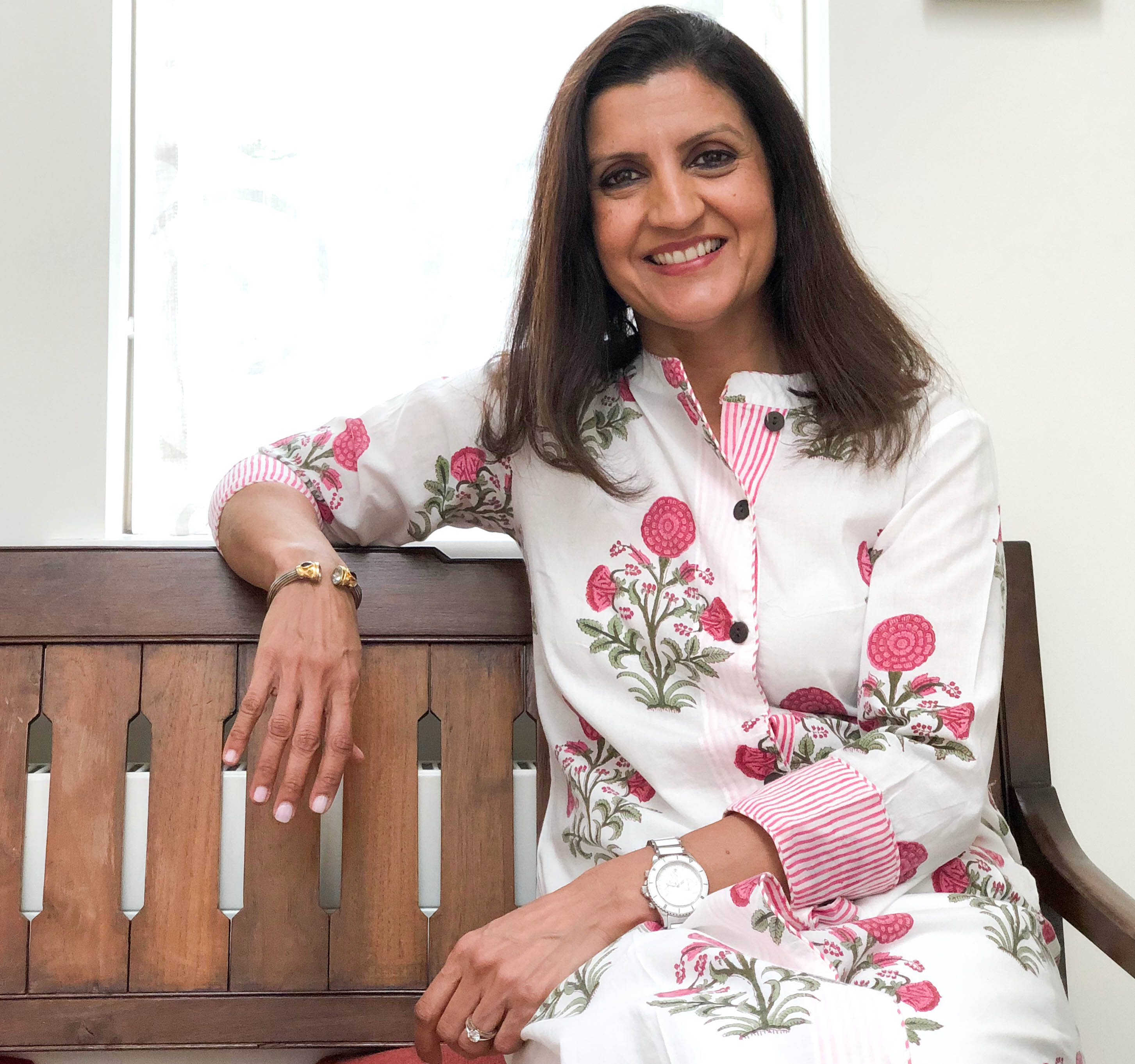 Woman in Indian Dress on bench, Deepa Mer nutritionist